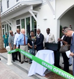 Beaufort County Black Chamber of Commerce President Larry Holman cuts the Grand Opening Ribbon.