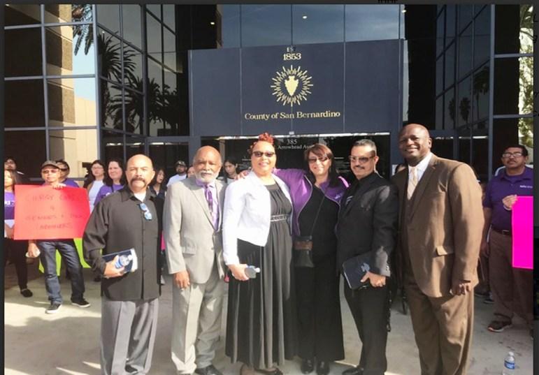 SEIU 2015 Executive Vice President Kim Evon and clergy leaders