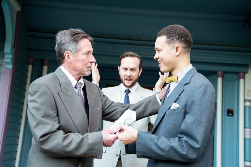 """The Father (David Critchlow) hands over an inheritance to his youngest son Bobby (Jaylen Baham) over the objection of his eldest son William (Chris Coon) in LifeHouse Theater's original musical """"Prodigal Son"""" (January 5 - 27, 2019). [photo by Elizabeth Ekema-Nardella]"""