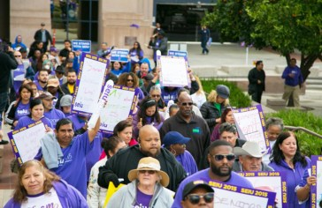 Workers, care recipients, and activists march outside of Board of Supervisors building