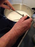 Warming the milk for the cheese