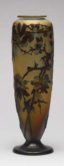 Emile Gallé - Vase with Cherry Tree Branches - Inspired by the Chinese glass he had seen during a trip to Berlin, Emile Gallé began to work with opaque colored glass in 1884. Within four years, he developed a technique of working with cased (layered) glass in which Art Nouveau or Japanese-inspired designs were etched through the outer layers with acid to create inexpensively a carved cameo effect. Most of Gallé's pieces were mass-produced at the glasshouse of Burgum and Schverer in the town of Meisenthal in eastern France. Production of his works continued there after his death until World War I.