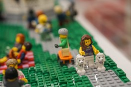 Lady walking two dogs in LEGO display at Myer