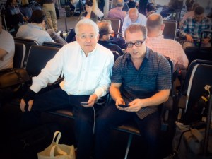 Michael Peck and Mark Unger diligently prepare for their flight to ABA Techshow 2015 by texting the pilots directions (they like that)