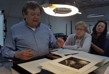 John Balkwill, owner of Lumino Press, sharing a project with SBP members Joyce and Yessy