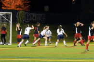 The girls react after Sadie Singer knocks in the game-winner