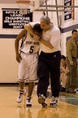 Coach Hickey and Aaron Frazier share a moment with the game in hand