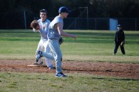 Don Liotine flips the ball to Ryan Haas for a fielder's choice