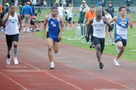 Andrew White burns up the straightaway in the 100