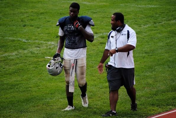 Coach Ryan talks with Jerome Washington