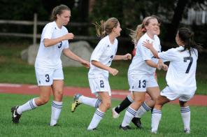 The girls celebrate Barker's goal