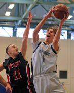 Mac Bohuny elevates for 2 of his 14 points