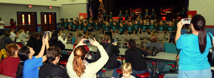Gauthier students perform the D.A.R.E. song for their relatives who attended and some of them videotaped the performance.