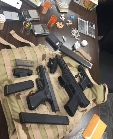 Heroin, guns and bullet-proof vest seized in the case