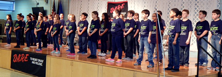 OLPS students perform the D.A.R.E. theme song.