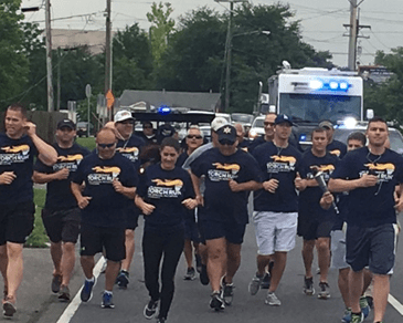 Participants in the Law Enforcement Torch Run for Special Olympics running on West St. Bernard Highway.