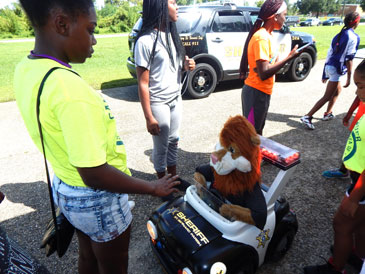 A popular feature for the children was the remote control car carrying Daren the Lion, national mascot of the Drug Abuse Resistance Education program, or D.A.R.E., which is taught by sheriff's deputies in St. Bernard Parish schools.