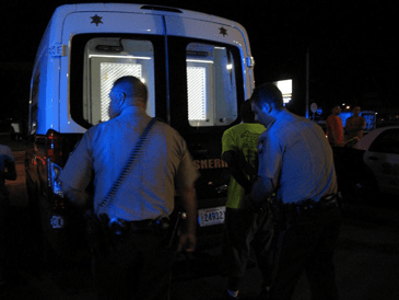 A man is arrested during the check point.