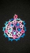 5 Point Celtic Motif tatted by Natalie. Lizbeth thread size 40. Round 1 color Purple Iris Fushion (162). Round 2 & 3 colors Pink Blossoms (176) and Peacock Blues (149).