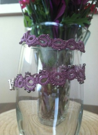 This bracelet was tatted by Michele Merrill. It is made from a pattern called Bracelet by Jennifer Williams. Very simple and fun to make. Tatted in Lizbeth #20 in Antique Violet.
