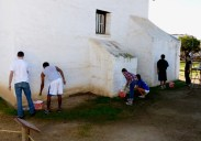Cate School volunteers whitewashing the rear buttresses of the Presidio Chapel. Photo by Michael H. Imwalle