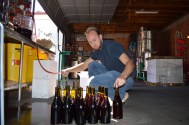 Gabe Smith gravity filling wine bottles. Photo by Michael H. Imwalle.