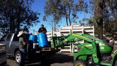 """Tom Walton picking up 120.9 gallons of """"Liquid Sunshine"""" from Figueroa Farms. Photo by Leanne Haslouer."""