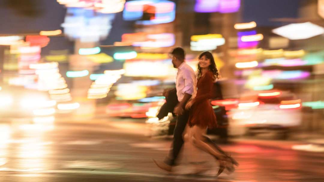 Man and woman crossing the Las Vegas Strip