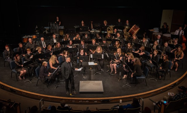 SC4 symphonic band pictured on stage in the Fine Arts Theatre.