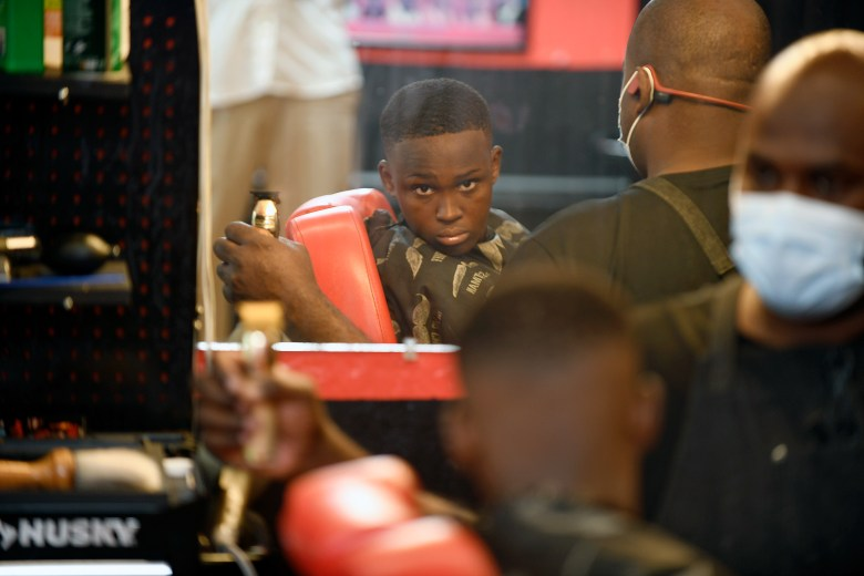 Camden Woods, 13, checks his haircut at Daddy's Choice Barber Shop in Jonesboro, Arkansas on August 6, 2021. Woods is vaccinated.