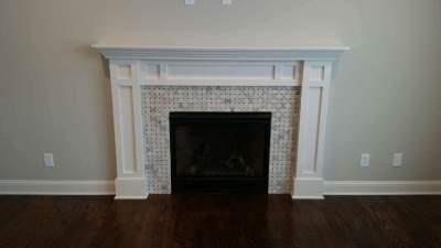 Custom designed fireplace & surround with decorator tiles.