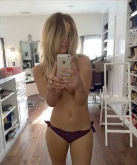 Kaley Cuoco topless selfie in a mirror with boob slip