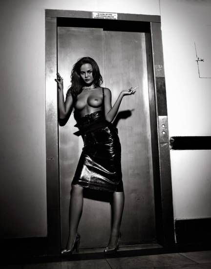 Chrissy Teigen tits in front of elevator