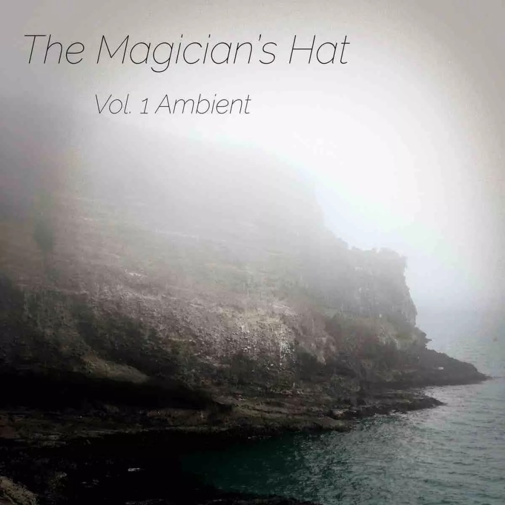 Atmospheric photo of rocks with a heavy misty over them, very dramatic. A text across the top reads The Magician's Hat, Vol 1 Ambient