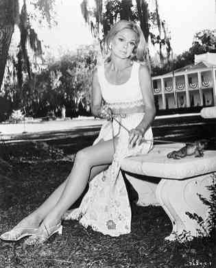 Lynn Borden and a frog on a leash. This picture is much more interesting than the movie itself.