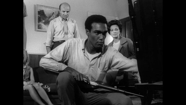Duane Jones (Ben) prepares for the zombie apocalypse, while Karl Hardman (Harry) runs interference in Night of the Living Dead (1968). Marilyn Eastman (Helen) watches on.