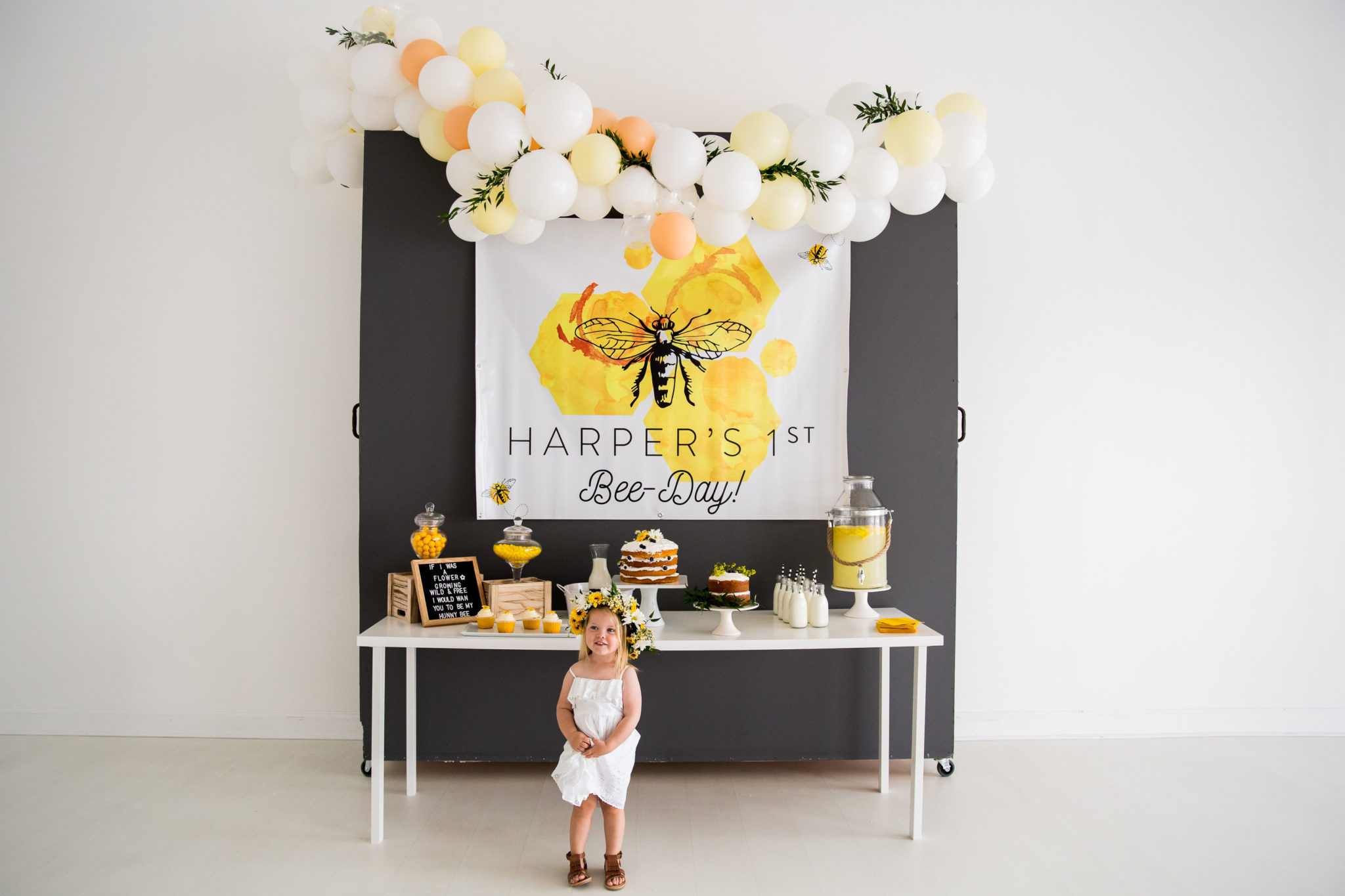 bee themed 1st birthday display with little girl