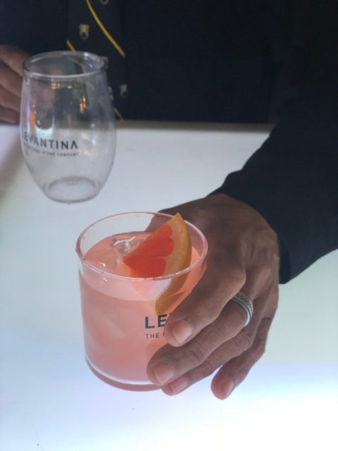 signature cocktail with citrus wedge
