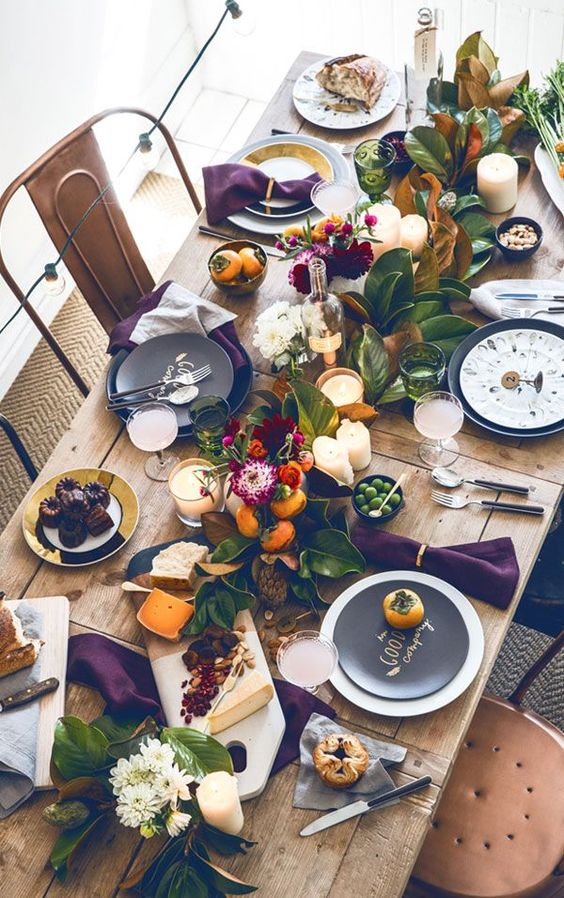 modern farmhouse industrial Thanksgiving table with greenery and candles