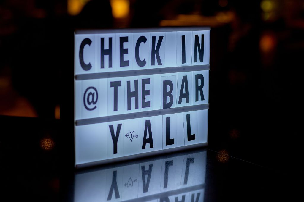 check in @ the bar y'all sign on bartop