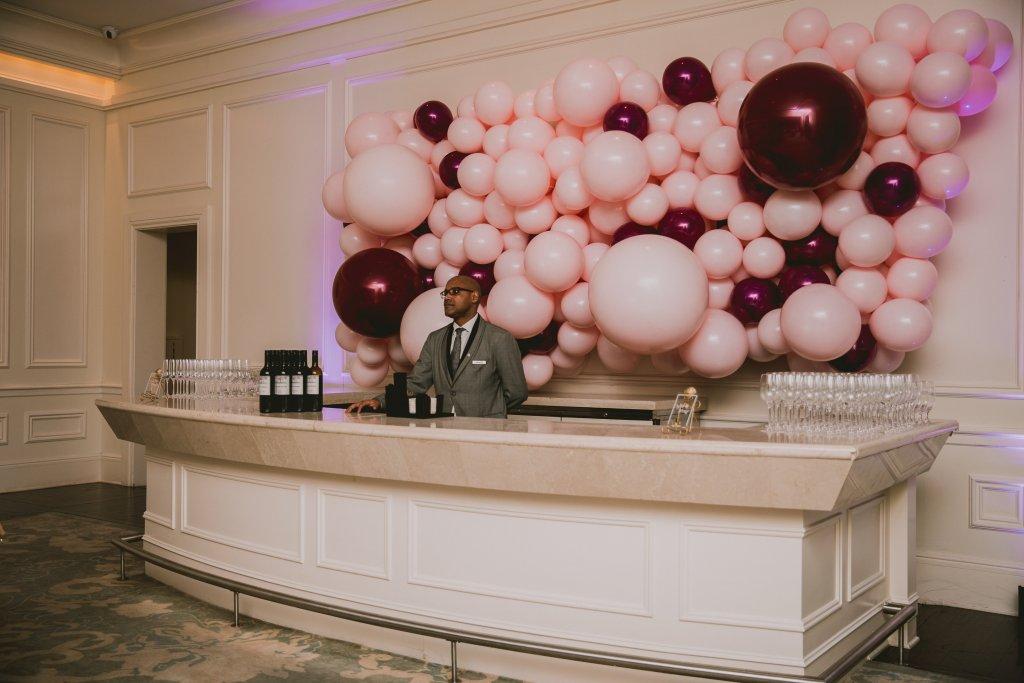 St. Regis Atlanta concierge with balloon installation