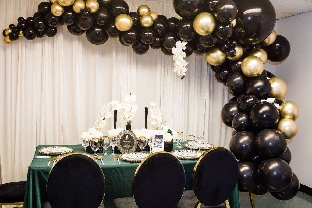 emerald green table with black and gold seating