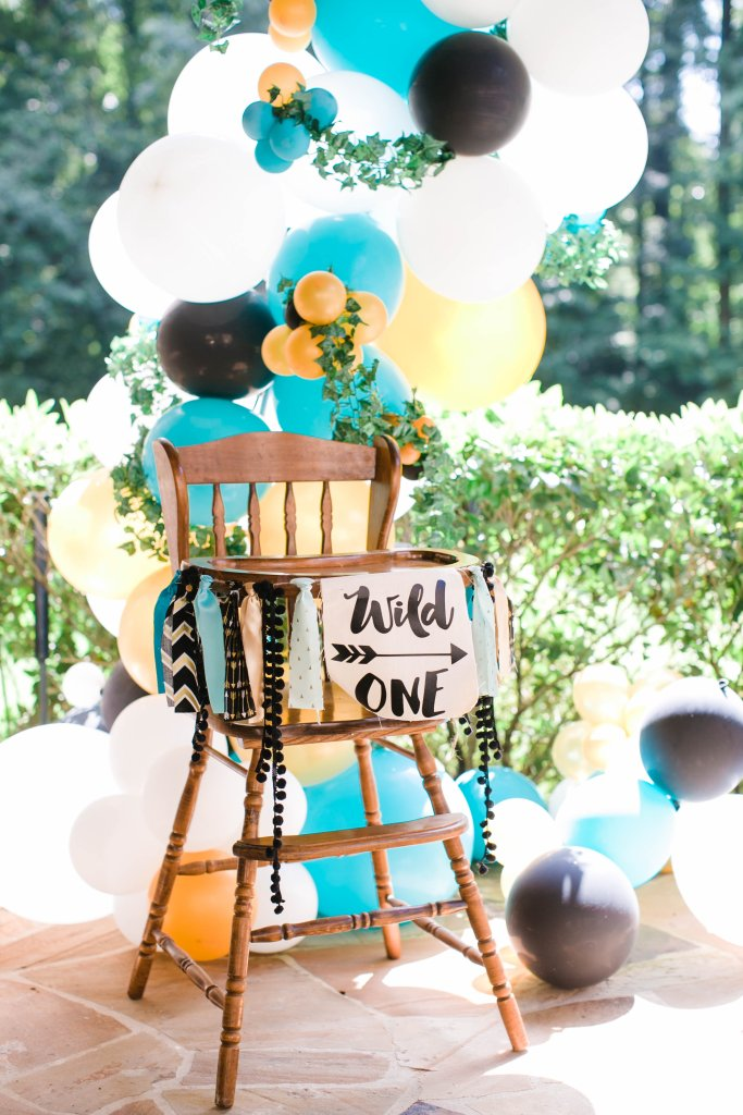 Wild One high chair and balloon installation