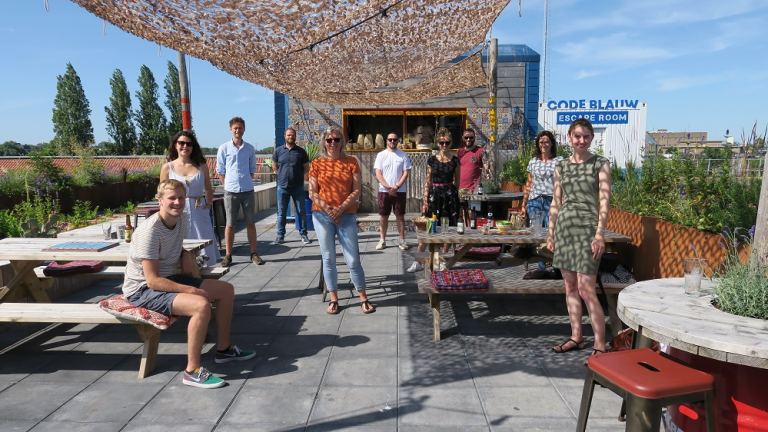 A group photo of members of the Neuro-D lab Leiden standing outside on a patio.