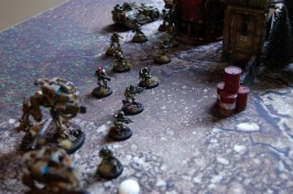 Elysian Droptrooper infantry supported by Sentinels and Tauros buggies.