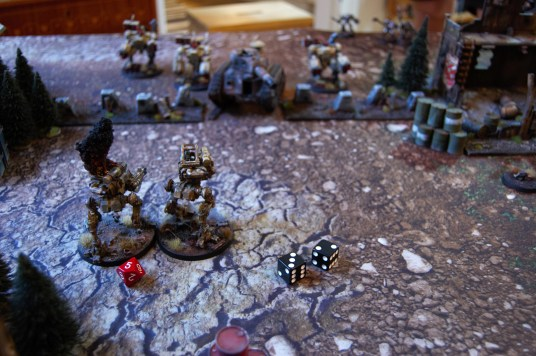 The broadsides split their fire between the Terminator squad in the back and the Drop sentinels in front of them...