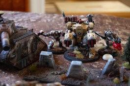 Brother Captain Severus lands a powerful blow with his Nemesis deamonhammer into the back of the battlesuit, killing it in an instant!