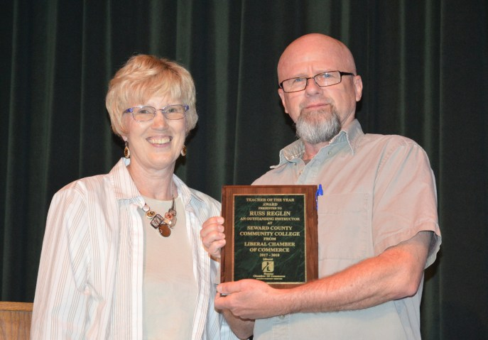 Liberal Area Chamber of Commerce director Rozelle Webb and SCCC Instructor of the Year, Dr. Russ Reglin.