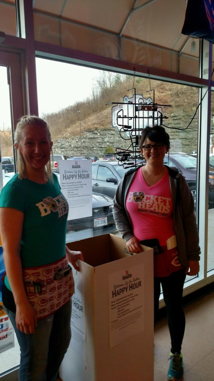 Lovely ladies at Bucketheads with a donation bin