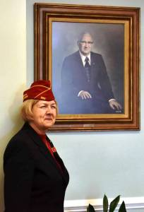 American Legion National Commander Denise Rohan with Roy E. Stone, Jr.'s portrait.